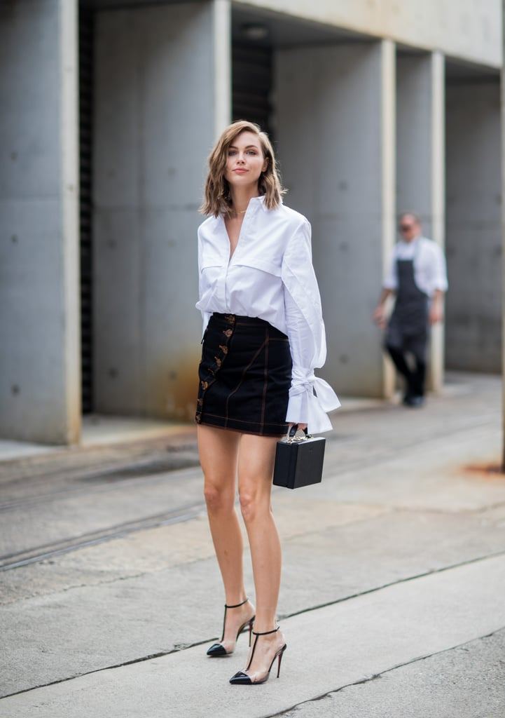 We love how a classic button down perfectly complements a miniskirt.