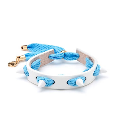 Make an ode to all things punk with this Caroline Baggi punky bracelet ($85); we love the white and blue color combination.