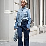 For a fresh take on double denim, half-tuck a denim shirt into wide-leg jeans and finish with bright red shoes.