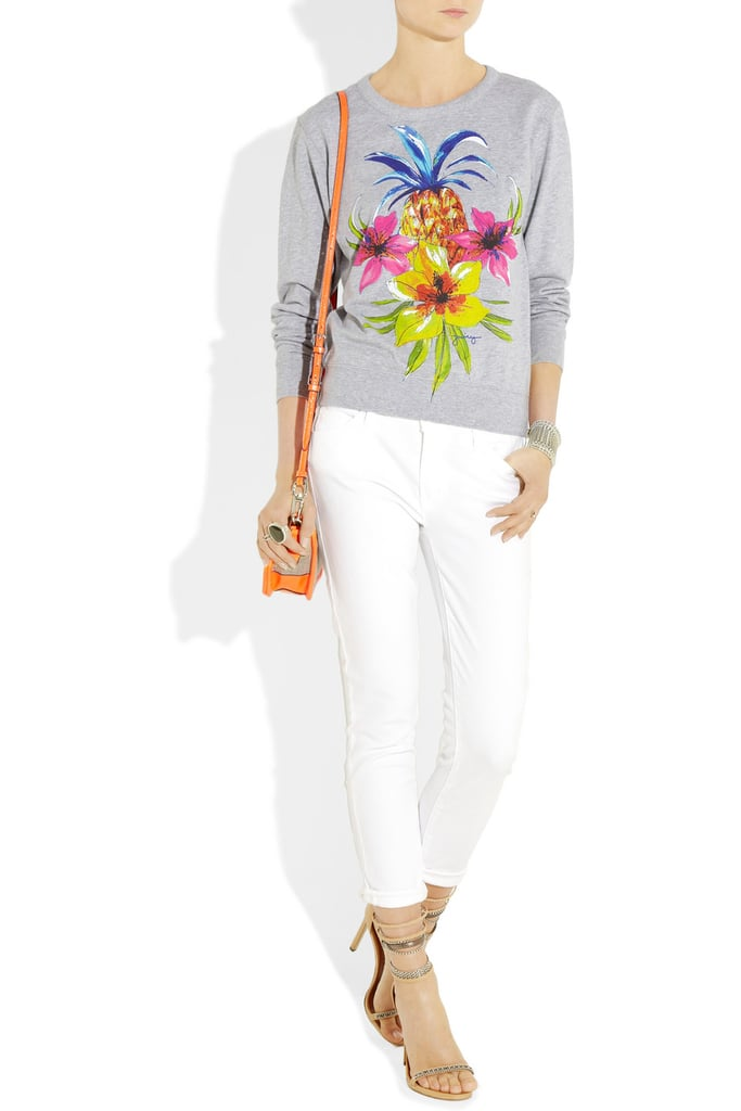 Top your look off with a cheeky tropic print-infused sweatshirt.  Juicy Couture Tropical Print Sweatshirt ($88)