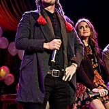 Nikki Reed watched Jackson Rathbone wear a funny hat on stage.