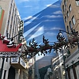 Santa Claus and his sleigh sail over Hollywood in Disney California Adventure.