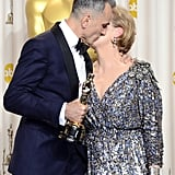 Daniel Day-Lewis and Meryl Streep shared a kiss in the press room.