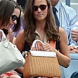 Pippa just loves her Kate Spade white leather and wicker bag.