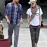 Diane Kruger paired her favorite straw fedora and slick sandals with her black-and-gray printed pants.