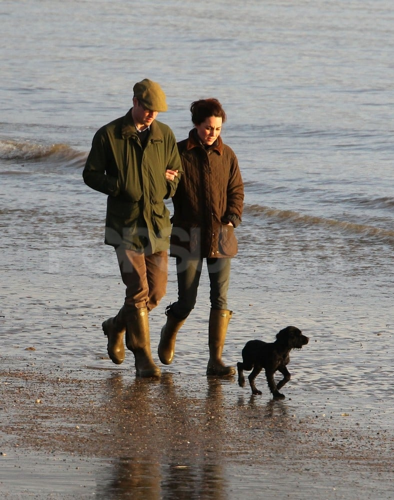 "Prince William and Kate Middleton took their new puppy for a stroll in Wales last week. The family of three took a walk along water in their current hometown of Angelsey. It was the first time the Cocker Spaniel was seen with William and Kate, and palace officials have since confirmed that the dog is, in fact, theirs. A spokesperson said the spaniel is ""a few months old"" and came from ""a close family connection."" William and Kate were able to enjoy a warmer climate recently, though. They went on vacation with her parents, Michael and Carole Middleton, to the island of Mustique. Pippa and James Middleton went along as well. The getaway came before William is due to head off this evening on tour of duty in the Falkland Islands as a member of the Royal Air Force — to mark his mission, take a look at the best pictures of Prince William in uniform."
