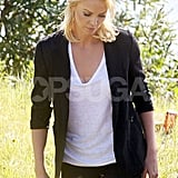Charlize wore a simple t-shirt and black blazer.