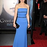 For the Game of Thrones season-three premiere in LA, Emilia Clarke chose a beautiful blue gown by Victoria Beckham. We love that she kept her neck bare and only accessorized with a black satin Christian Louboutin clutch and a simple bracelet.
