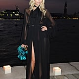 Natasha Poly opted for a black sheer Gucci gown and silk turquoise clutch at the Gucci Award For Women in Cinema event.
