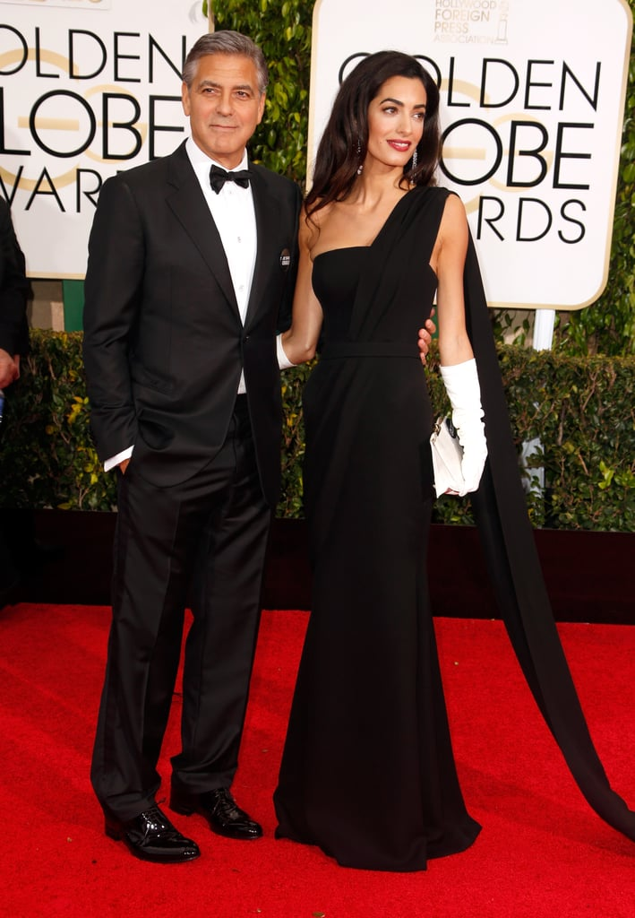 Wearing an Old Hollywood-inspired Dior gown at the 2015 Golden Globes. She accessorized with a pair of classy white gloves.