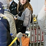 Jessica Alba patiently waited for her luggage to come off the plane.