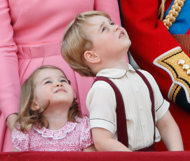 Neither the prince or the princess could keep their eyes off the air show that took place during the Trooping the Colour celebration in July.