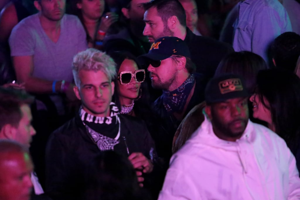 """Well, well, what do we have here? On Saturday, Rihanna and Leonardo DiCaprio were spotted hanging out together just a few miles from Coachella at Neon Carnival. While they didn't show any PDA, the pair kept things low-key in sunglasses — and Leo with a baseball cap — and were seen having a conversation in the middle of a crowd.  Of course, this isn't the first time these two have fueled romance rumours. In January 2015, it was reported that Leo helped plan Rihanna's 27th birthday bash, at which sources told People the two got flirty while dancing together. That same month, Rihanna met up with Leo at a club in Paris, though sources reported that the duo were """"just friends."""" Keep reading for more photos, and then see what happened when Jennifer Lopez texted Leo during her epic Carpool Karaoke session."""