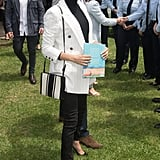 Meghan Markle Work Outfit Idea: A Turtleneck, Pinstripe Blazer, and Jeans