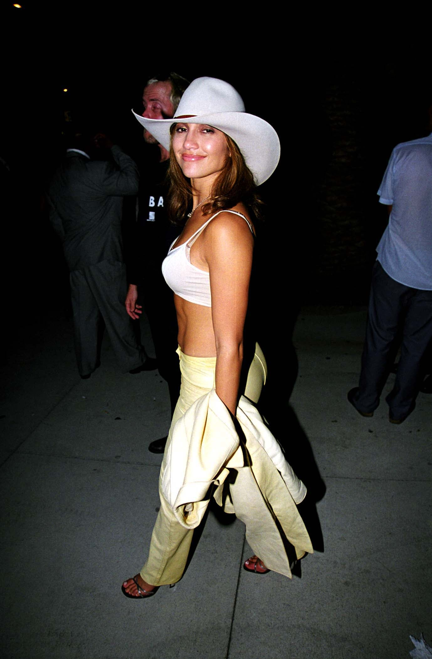 Rocking a cowboy hat and bared midriff at the 1998 MTV VMA Maverick party.