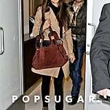 Nina Dobrev traveled in a khaki trench.