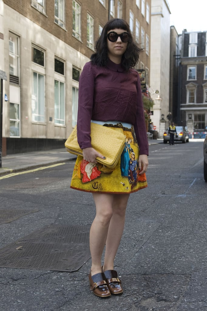 A whimsical skirt was tempered with a burgundy blouse and menswear-style loafers.