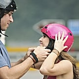 Ben helps his former flame Ashley with her helmet.