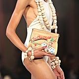 Cha Cha Cha-emblazoned clutches that paid homage to the ultimate Brazilian bombshell, Carmen Miranda.