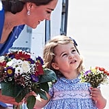 Even with gorgeous flowers in her hands, Kate was peering over at her little girl (and as usual, something out of the shot had Charlotte's undivided attention).      Related:                                                                                                           The Adorable Thing Kate and William Always Do When They Talk to George and Charlotte