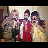Kim Kardashian munched on mustache-shaped cookies with friends.  Source: Instagram user kimkardashian