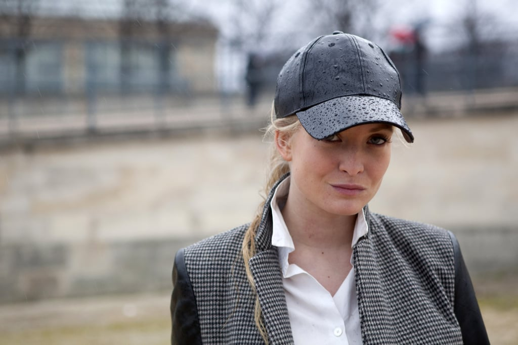 Blogger Natalie Helgerud shielded her hair from the Paris rain with a leather H&M baseball cap.