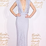 A lilac lace gown by Burberry Prorsum with a plunging neckline showed off Suki's model figure at the British Fashion Awards in December 2013.