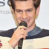 Andrew Garfield held the microphone at the press conference for The Amazing Spider-Man in Japan.