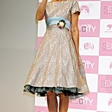 SJP waved to fans in a lace-and-tulle confection, adorned with a baby blue sash and gemstone brooch, at a Tokyo press call in 2004.