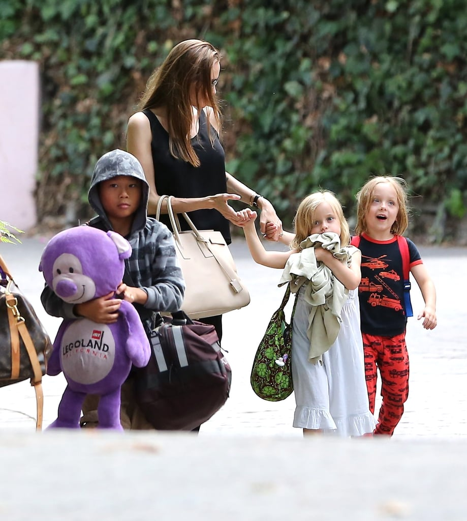 Angelina Jolie enjoyed some time off with her kids over Labor Day weekend, stopping in Santa Barbara with Pax and the twins on Monday. Pax carried the giant stuffed bear that he regularly holds on to when the family travels, and Vivienne cuddled up with a blanket while she and Knox held hands with Angelina.  Earlier in August, the family enjoyed some time at the Disneyland theme park while Angelina attended the D23 Expo to promote her upcoming flick, Maleficent. She's been on the go throughout the Summer, taking flight with Maddox for a trip to London and heading overseas to Tokyo with the twins and her partner Brad Pitt after attending the Japanese premiere of World War Z. This past weekend, Brad did some promoting on his own when he hit the stage with Michael Fassbender at the Telluride Film Festival for their film 12 Years a Slave.