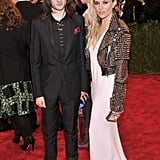 New parents Sienna Miller and Tom Sturridge left baby Marlowe at home to walk the red carpet in punky Burberry studs (for her) and boots (for him).