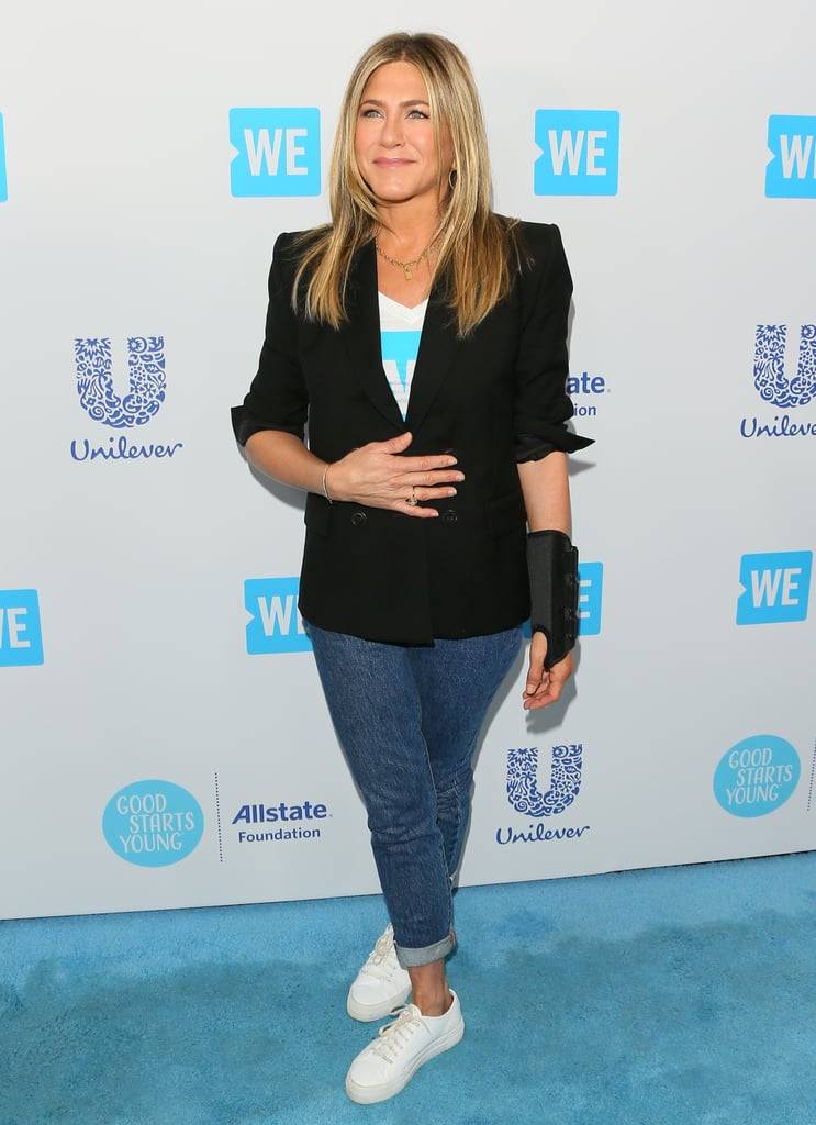 "After dressing up for Gwyneth Paltrow's engagement party, Jennifer Aniston made a more casual appearance at We Day California in Los Angeles. For the blue carpet, Jennifer dressed down in a black blazer and jeans — call this her uniform — and smiled for the cameras. It was her first official public outing since splitting from Justin Theroux. You'll notice she skipped her superskinny jeans in favor of a straight-leg style, which was cuffed at the ankles. (The star once said she ""loathes"" skinny jeans, but wore them because Justin ""enjoys [her] in [them].""). Well . . . now Jennifer doesn't have to wear them anymore! Her cuffed jeans showed off a pair of white platform sneakers, which tied neatly into her laid-back ensemble. Stars are opting for sneakers now more than ever on the red carpet, and it seems Jen is fully on board. Meanwhile, on the other end of the spectrum, Selena Gomez, who also attended the event, wore shoes with a structural heel made of knots. If you're more of a sneaker gal, however, read on to check out Jennifer's full look. Then, shop similar platform kicks ahead."