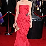 At the 2010 SAG Awards, Carey lit up the red carpet in a frothy Lanvin gown, adorned with a pearlized brooch, champagne clutch, and dainty drop earrings.