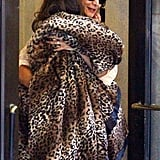 Suri Cruise held tight to mom Katie Holmes in a leopard blanket in NYC.