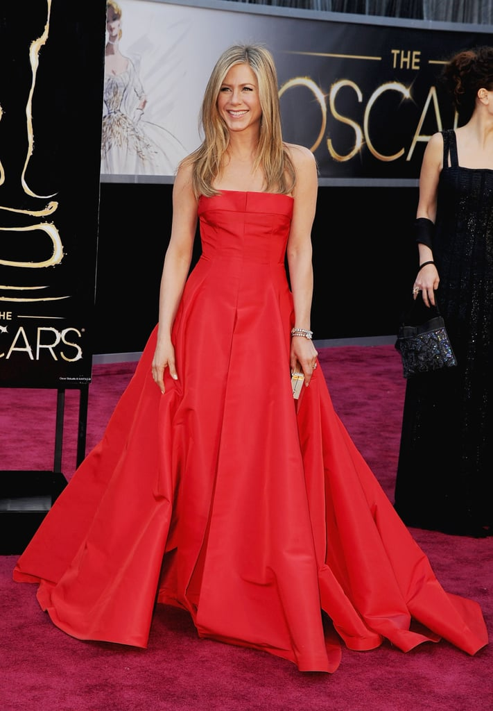 Jennifer Aniston wore a red Valentino number to the Oscars.