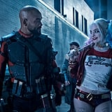 Deadshot and Harley Quinn share a knowing glance.