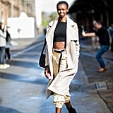 Give Your Trench Coat a Relaxed Look With a Crop Top, Cargo Pants, and Ankle Boots
