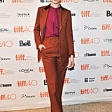She wore this orange and brown suit set to the 2015 Toronto International Film Festival. Her pantsuit collection is endless.