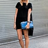 If you opt for a t-shirt-style black dress, stick to a downtown vibe with studded booties, like these Chloé ones, a bold-colored clutch and a wide-brimmed felt hat.