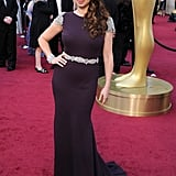 Funny girl Maya Rudolph wore a purple Johanna Johnson gown with silver detailing — we love her long curly side-swept 'do.