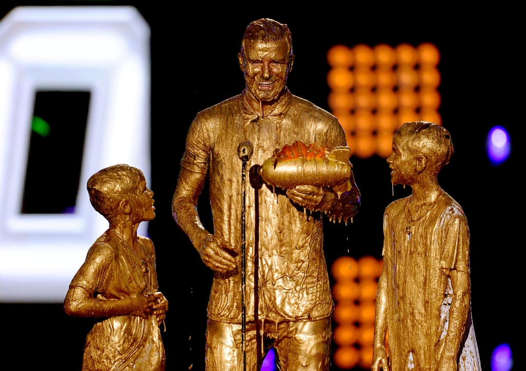 David, Romeo, and Cruz were covered in gold slime while accepting a trophy on stage at the Kids' Choice Sports Awards in July 2014.