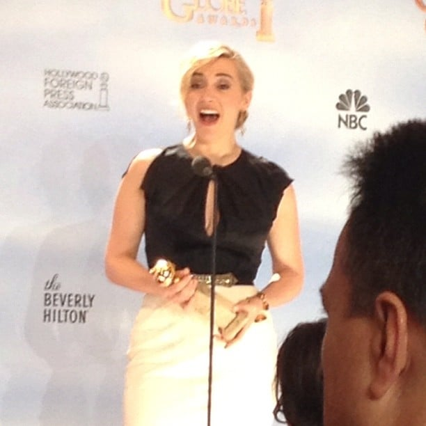 Kate Winslet lit up the press room with her electric smile backstage at the Golden Globes.