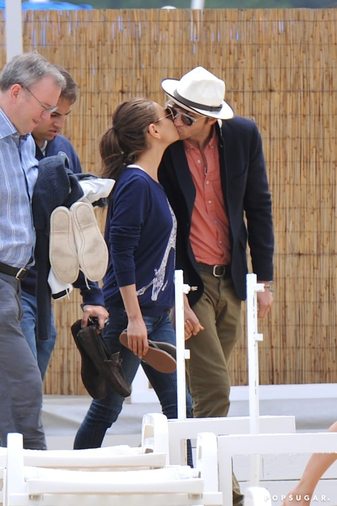 Ashton Kutcher stole a sweet kiss from girlfriend Mila Kunis in June in the South of France.