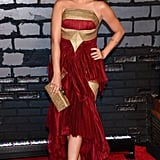 Sarah Hyland was regal in a red-and-gold Marchesa gown. She added a gold embellished clutch and black platform sandals to the mix to complete her red carpet look.