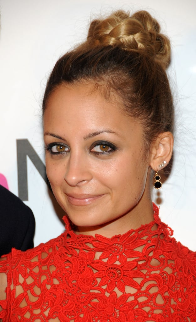 Nicole Richie wore a braided bun and earrings to the event.