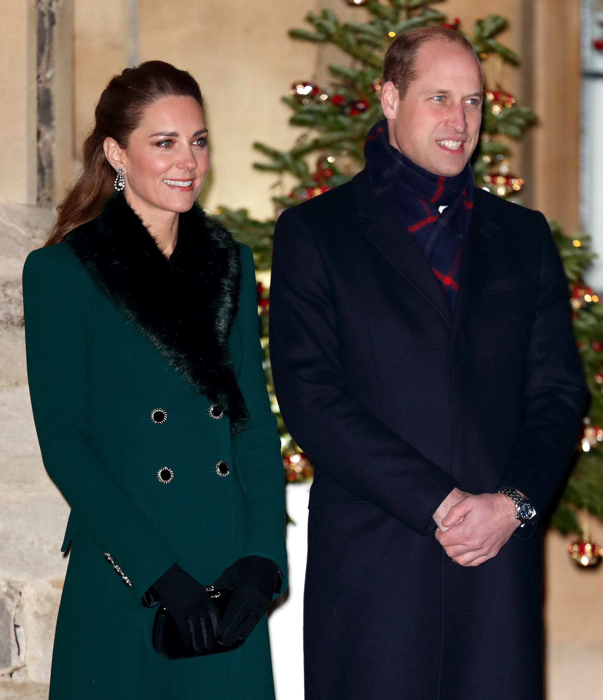 WINDSOR, UNITED KINGDOM - DECEMBER 08: (EMBARGOED FOR PUBLICATION IN UK NEWSPAPERS UNTIL 24 HOURS AFTER CREATE DATE AND TIME) Catherine, Duchess of Cambridge and  Prince William, Duke of Cambridge attend an event to thank local volunteers and key workers from organisations and charities in Berkshire, who will be volunteering or working to help others over the Christmas period in the quadrangle of Windsor Castle on December 8, 2020 in Windsor, England. During the event members of the Royal Family also listened to Christmas carols performed by The Salvation Army Band. (Photo by Max Mumby/Indigo - Pool/Getty Images)