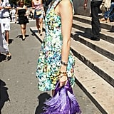 Olivia is never one to shy away from striking prints, like when she donned this chic floral frock. Equally standout accessories were a purple bag and eggplant satin pumps.        Day Dresses by Rebecca MinkoffPumps by Enzo Angiolini