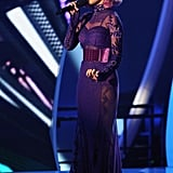 Katy Perry chose a Tom Ford purple lace gown embellished with a wide velvet belt while performing on stage at the VMAs.