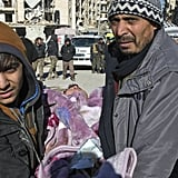 A Syrian child is carried during an evacuation of rebels and their families on Dec. 15.