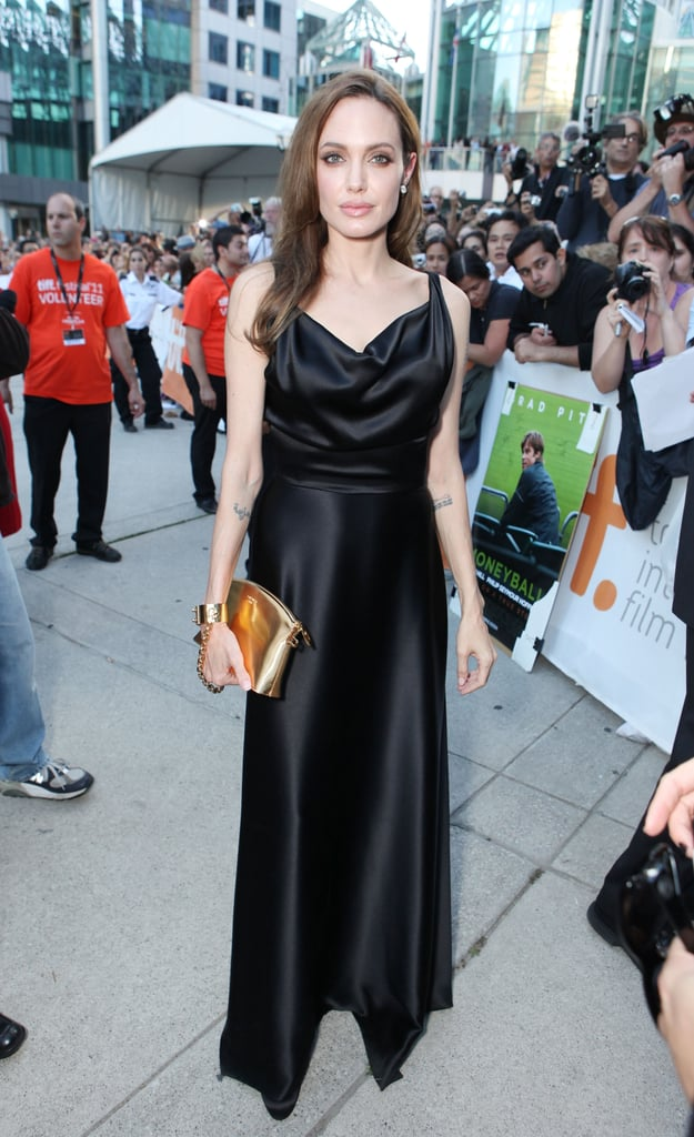 For the Moneyball premiere at the 2011 Toronto Film Festival, the actress kept thing dark and slinky via this bias-cut Vivienne Westwood gown.